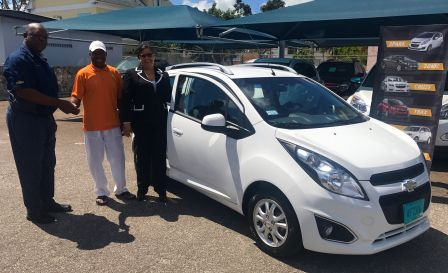 The winners of Nassau Motor Company's 77th anniversary 'Sweetheart Deal' drawing were handed the keys to their free Chevrolet Spark recently.